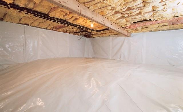 A vapor barrier covering the floor and walls inside a crawl space