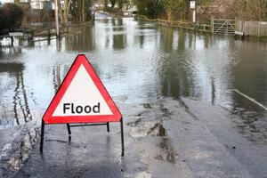 Flood in the street with sign