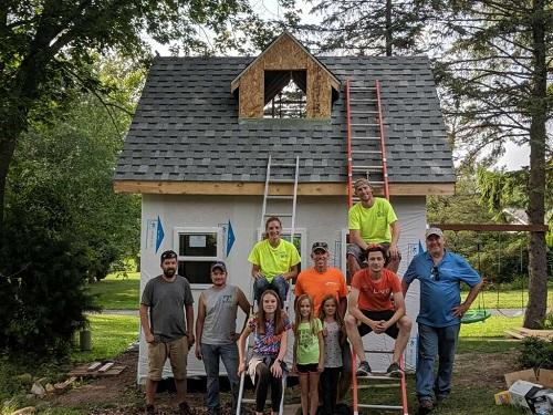 Buck Buckley's TBF Employees Volunteer To Build Fort for Local Pastor's Fam...