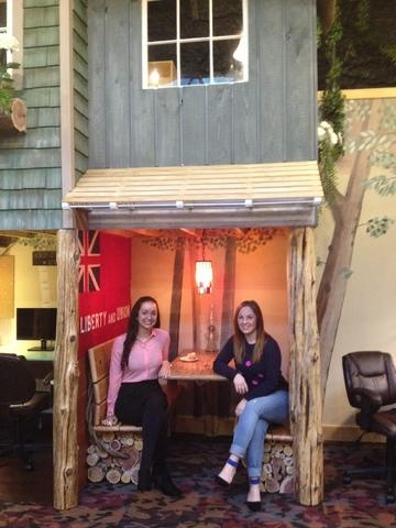 Account Manager Le Ann Arsenault, and Project Manager Lisa Barker. enjoying the meeting nook in Boomtown.