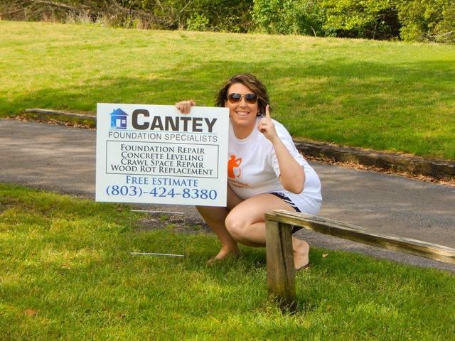 Heidi holds Cantey Sign