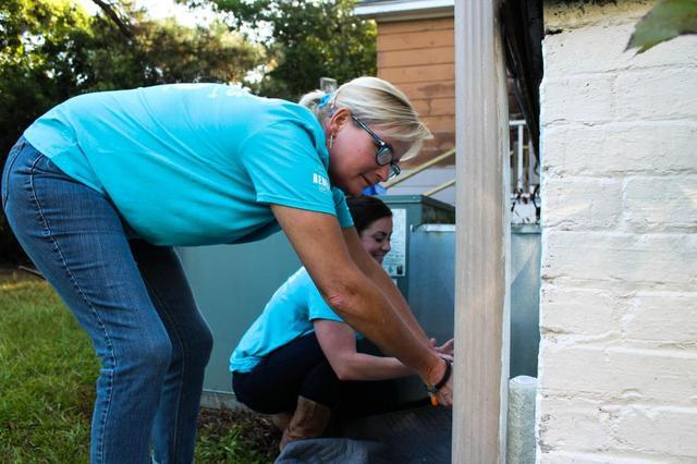 Team Members Kimberly and Brittany get started on some lower areas of the home.