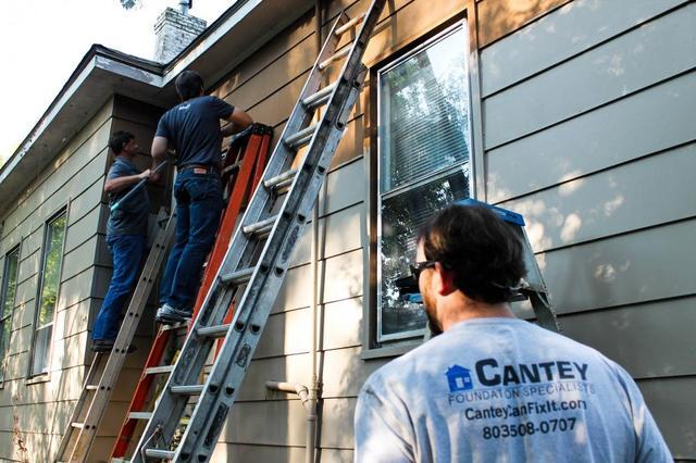 Owner William and CFO Mike get started on painting the siding.