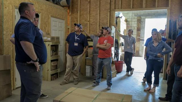 Production Project Manager Sean shows everyone around the warehouse which is where production begins.