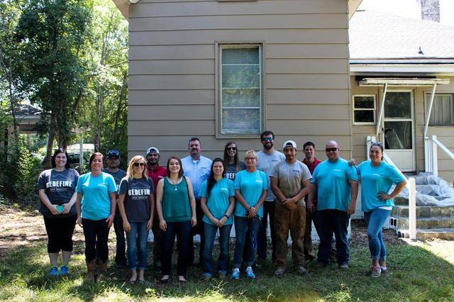 The whole team comes together for a photo after completing the Day of Caring activities.
