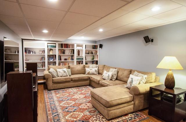 How do you turn windowless walls and low ceilings into welcoming and comfortable rooms? We've been working on basements for...