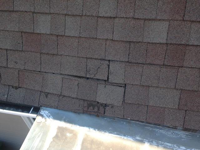 Old asphalt shingles that need replacement