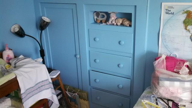 this built-in dresser with a shelf makes this room cold.