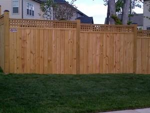 A little lattice on top of your fence can add a nice touch!...