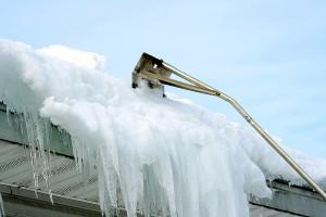 Heading South this Winter? Protect Your Roof from Snow