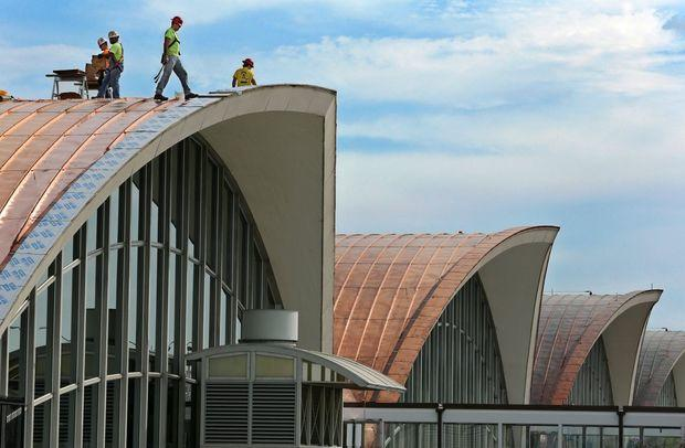 Domed roofs of St. Louis airport terminal topped with new copper material