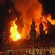 Parts of pitched roofs indicate extent of flames during fires
