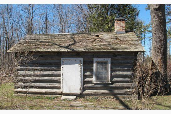 220-year-old cabin struggling under decaying roof