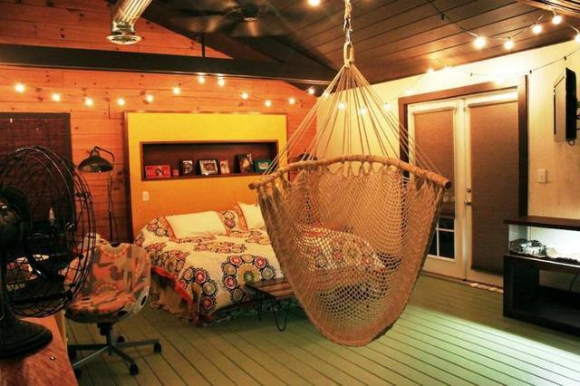 Bring that outdoor patio feel indoors by installing a comfy-cozy hammock inside your home! Grab a book, cue the sound...