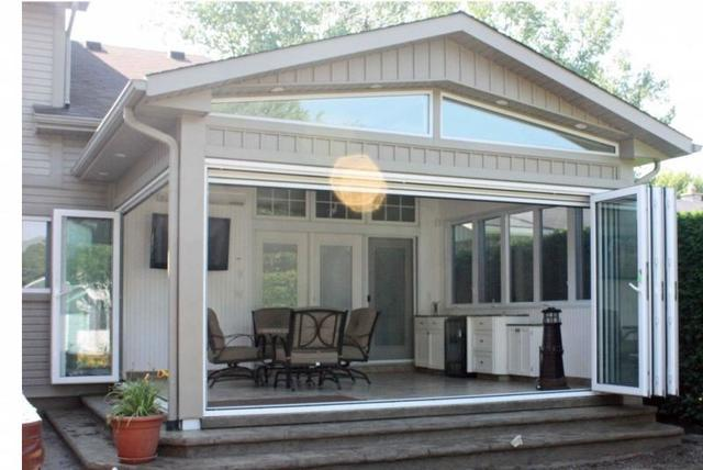 Relaxing Four Season Porch Design - Image 5