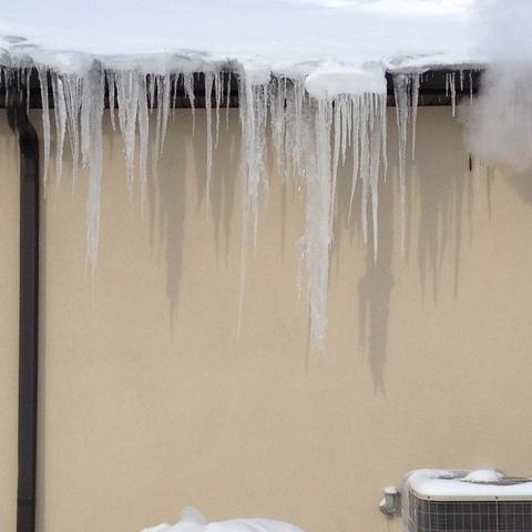 Dangers of Winter Snow to Your Home