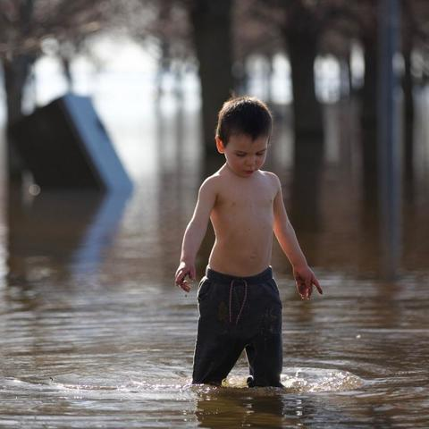 Boy playing in flood water