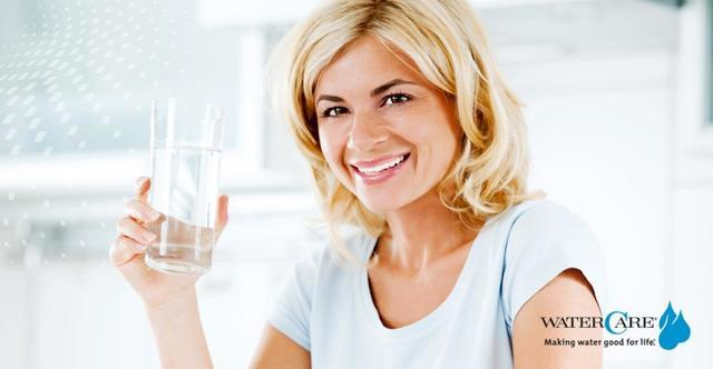 Woman Drinking holding a glass of water