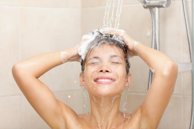 lady showering hard water soft water benefits skin care