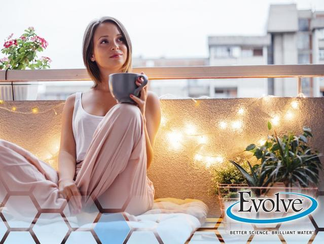 young woman with coffee mug on balcony