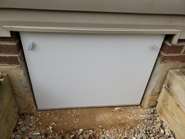 Replacing a leaky, deteriorating wood crawl space door with an EverLast Crawl Space Door is a smart upgrade.