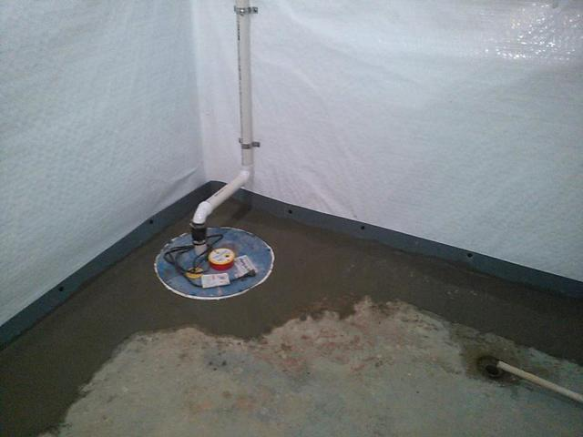 An interior drainage system with a sump pump