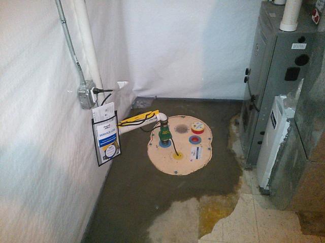 A sump pump in a waterproofed basement