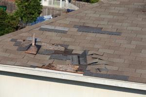 Hail damage caused shingles to loosen