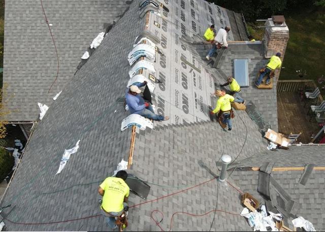 Klaus Roofing crew installing asphalt shingles