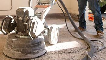 Removing an old epoxy garage floor coating with an industrial grinder