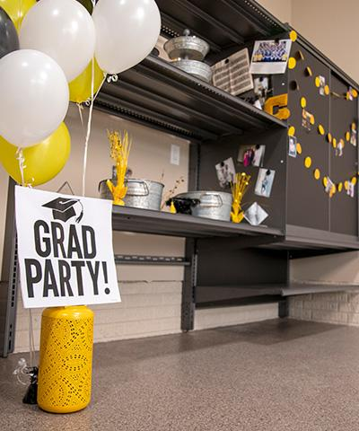 Garage party that is set up for a graduation party including a new garage floor coating and new garage storage.