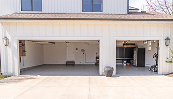 renovated three car garage with new cabinets and floor coating