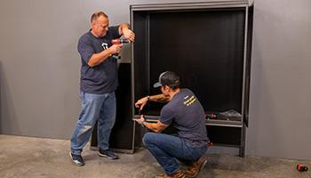 garage cabinet being professional installed by two people