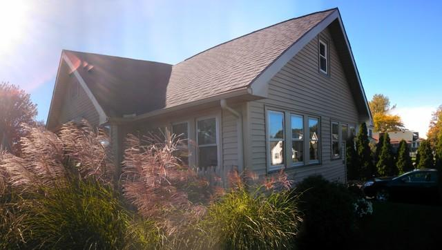 Fixed Cape Home in Greece, NY with Air Sealing, Insulation & Replacement Wi...