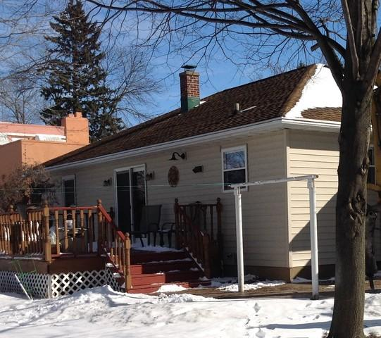 Replacing Old-Style Gutter Screens with LeafGuard Gutters in Chilton, WI