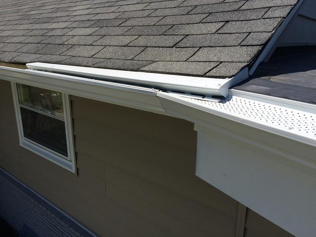 Creative Gutter Solution with Two Different Roof Styles in Andover