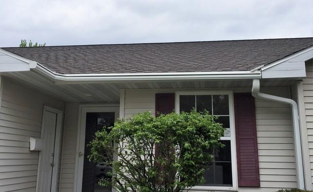 Failing Roof and Gutters with Screen Covers Need Replacing in Allouez, WI