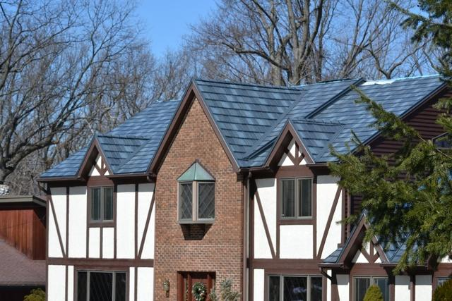 Tudor Style Home with Metal Roof