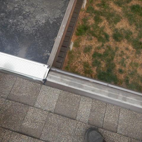 Flat Roof Gets Gutter Guards Installed in Mukilteo, WA