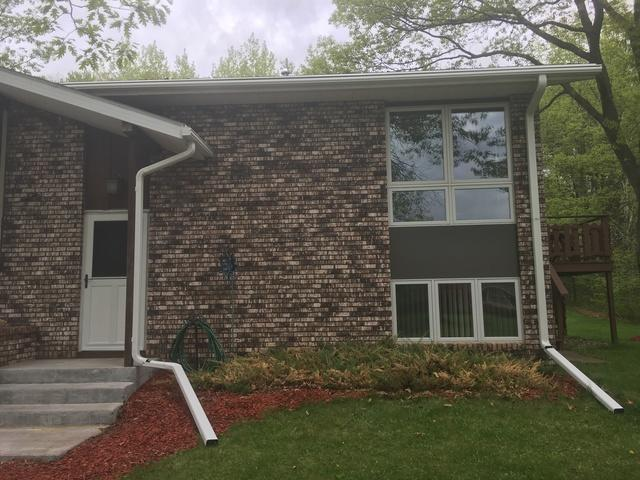 This Homeowner Has an Issue With Mature Trees and Difficult to Reach Gutter...