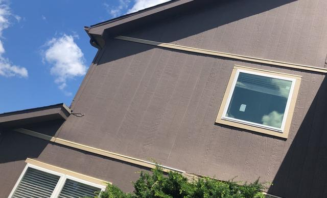 LP SmartSide Trim & Siding along with Vinylmax Windows Installed in Overlan...