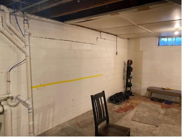 Basement Water Problem Solved, and Bowing Wall Repaired in Lincoln