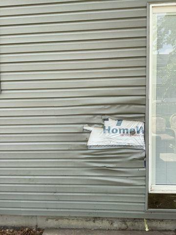 Melted Vinyl Siding in Bolingbrook