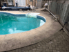 Concrete Pool Deck Brought Back from Disrepair in Pickering, Ontario