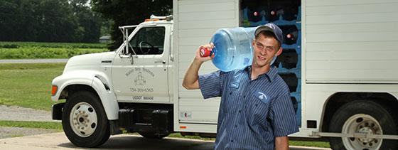 Water Boy Employee Carrying water jug