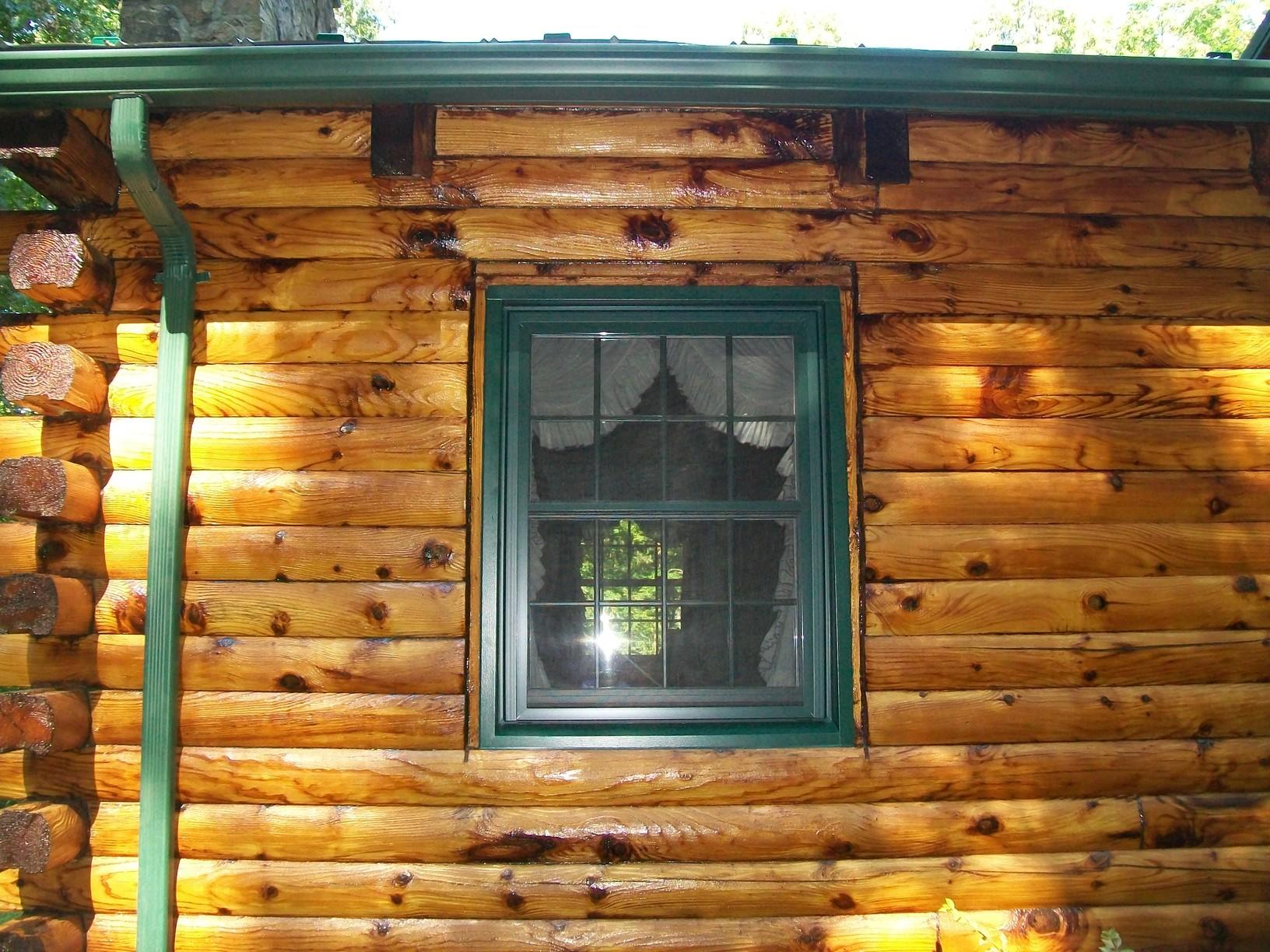 Enterior view of striking double hung installed in a log cabin home in Scenery Hill.