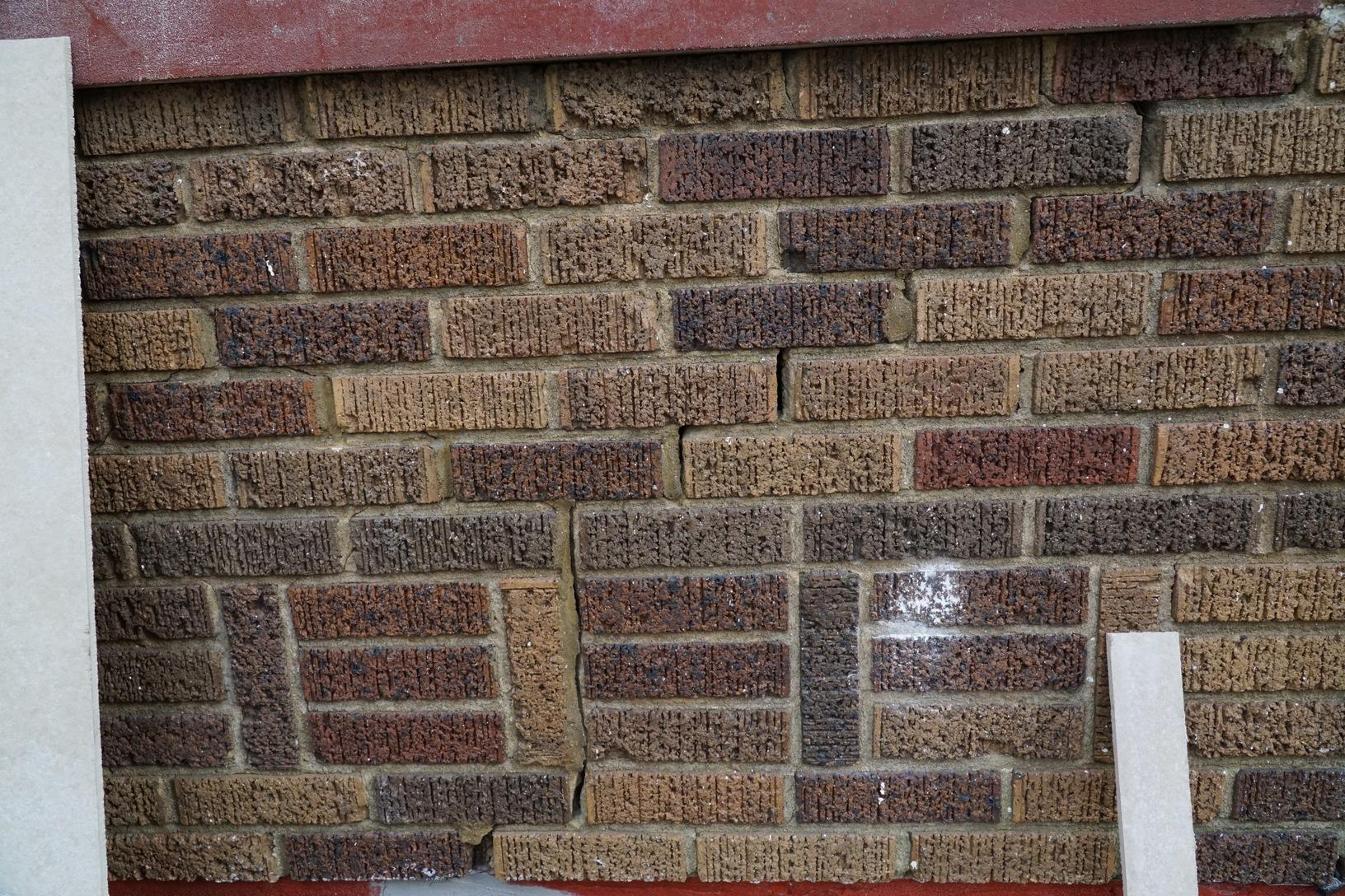 Stair step and vertical cracking in the brick exterior
