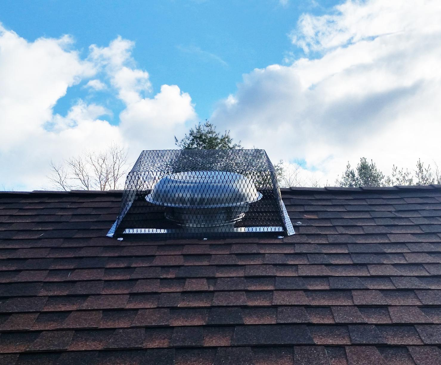 Installed wildlife attic fan exclusion