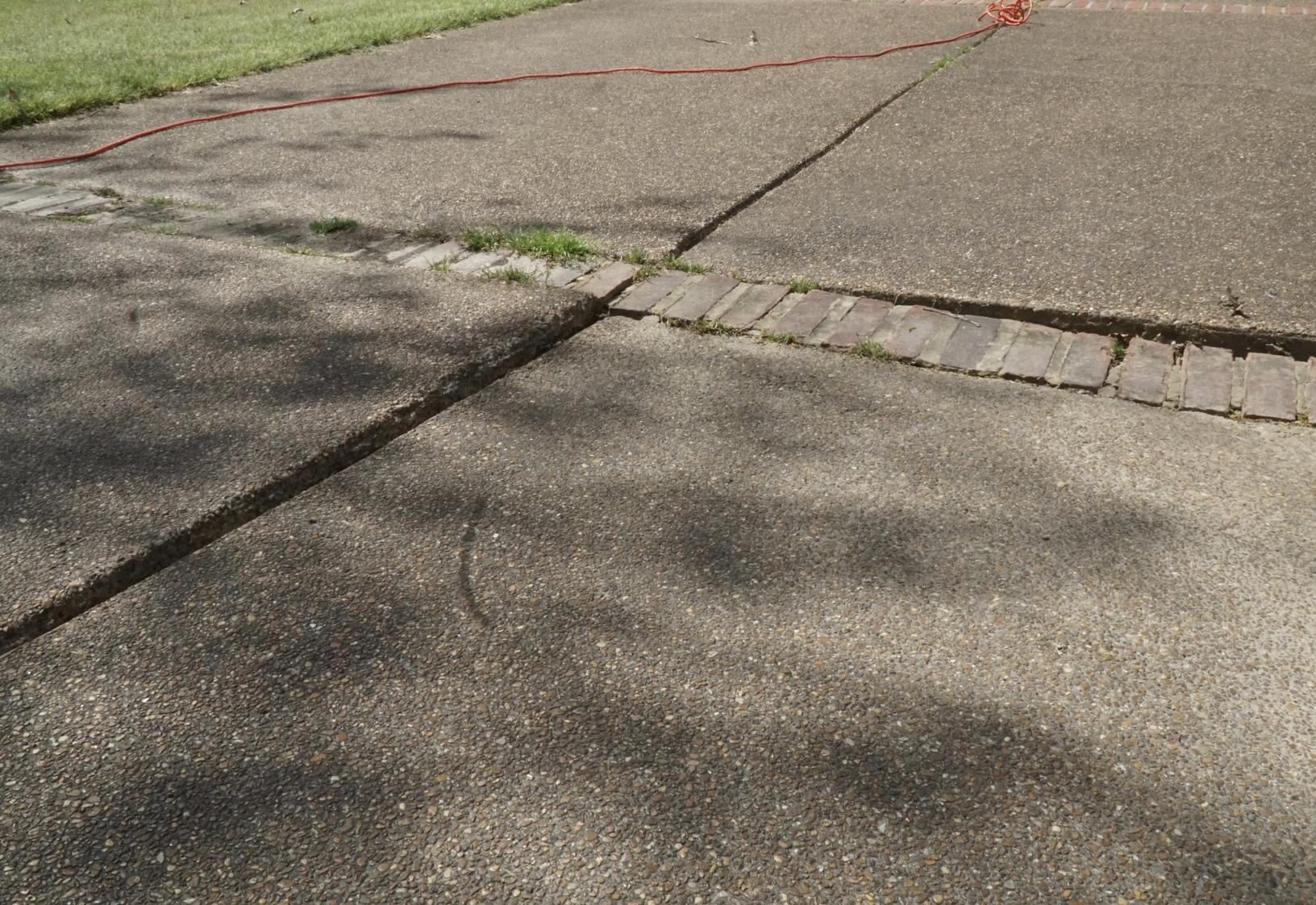 Before: sunken driveway slab