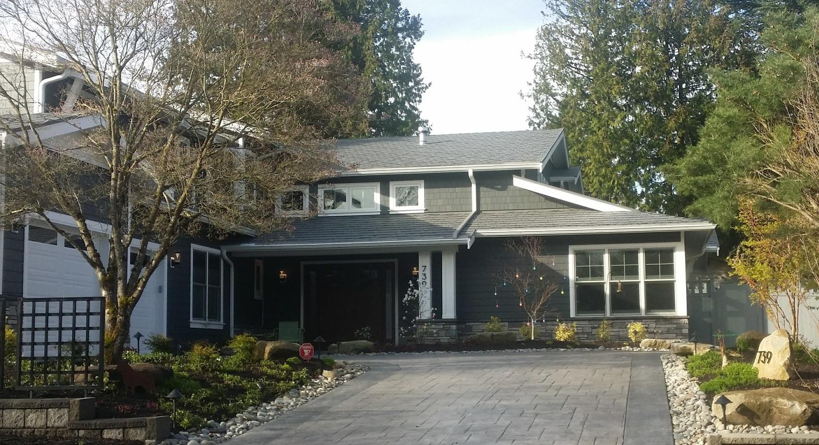 Kirkland, WA Stamped Metal Roof with MasterShield Gutter Guard for Fir Needles